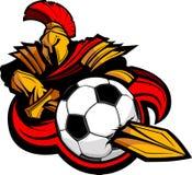 Corpo Trojan da mascote com a esfera de futebol Stabbing da espada Imagem de Stock Royalty Free