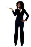 Corporate african lady presenting copy space. Full length portrait of corporate african lady presenting copy space against white background stock photo