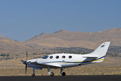 Corporate airplane on runway Royalty Free Stock Image