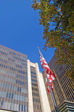 Corporate America. Flag in front of some corporate office buildings in downtown Sacramento, California Royalty Free Stock Image