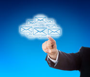 Corporate Arm Reaching Into Cloud Swarm Of Emails Stock Images