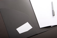 Corporate binder with white card and pen Royalty Free Stock Photos