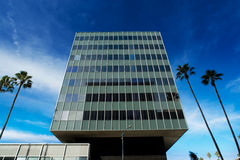 Corporate building. Corporate tower in the shape of a giant cube Royalty Free Stock Photo