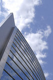 Corporate building. Image of a futuristic building and cloudy sky Royalty Free Stock Images