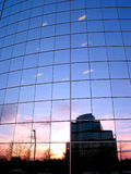 Corporate building. Reflection of a sunset in the mirror glass wall of a corporate building Stock Photo