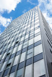 Corporate building. Blue sky and clouds reflecting in a glass Royalty Free Stock Images