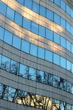 Corporate building Modern office architectural wave forms glass. Facade with windows of business office building group headquarters at sunset in Neuilly sur stock photos