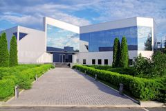 Corporate building in nature. Front of a bussines building in sunny day Stock Images