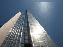 Corporate Building on Sunny Day. A shiny, tall, corporate building is captured on a crisp, sunny day stock photos