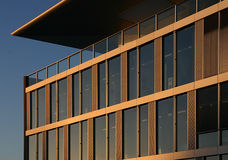 Corporate building in the sunset. Corner of a corporate building in the sunset light (Lausanne, EPFL Royalty Free Stock Images