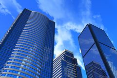 Corporate buildings. Blue reflective corporate buildings 3D illustration royalty free illustration