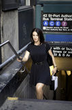 Corporate businees woman type standing next to the subway statio Stock Photos