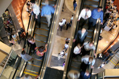 Corporate Business. People moving on escalators in a business setting Stock Images