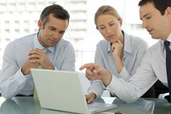 Corporate business teamwork - businessmen and woman working on laptop stock images