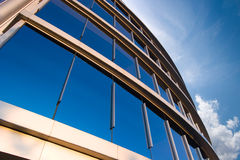 Corporate business office. Modern business office in perspective view beside blue sky Stock Images
