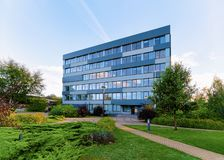 Corporate business office with street background. Vilnius, Lithuania - September 29, 2018: Corporate business office with the street on background royalty free stock photo