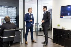 Corporate businessteam meeting and working in modern office. Royalty Free Stock Photography