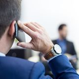 Corporate business team at business meeting and manager talking on phone. stock image