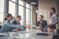 Corporate business team and manager in a meeting stock photos