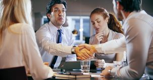 Corporate business team work office meeting. Four caucasian businessman and businesswoman people group talking strategy