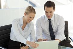 Corporate business teamwork - businessman working with woman on computer stock photos