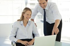 Corporate business teamwork - businessman working with woman on computer royalty free stock images