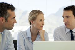 Corporate business teamwork - businessmen and woman working on laptop stock photos