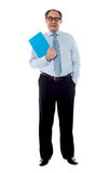 Corporate businessman holding document. Posing in style Stock Photo