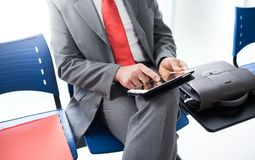 Businessman connecting with a tablet Stock Image