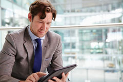 Corporate businessman using tablet computer, waist up Royalty Free Stock Images