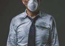 Businessman with mask and air pollution. Corporate businessman wearing a protective mask for air pollution, business and environmental care concept royalty free stock photography