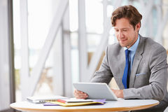 Corporate businessman working with tablet computer Royalty Free Stock Photography