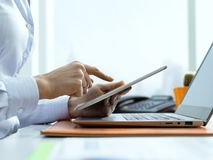 Corporate businesswoman using a digital tablet stock photos