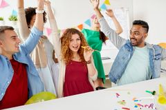 Happy team having fun at office party Royalty Free Stock Image