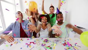 Happy team throwing confetti at office party. Corporate, celebration and holidays concept - happy team throwing confetti and serpentine at office party stock video