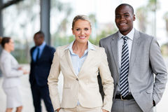Corporate co-workers. Professional corporate co-workers looking at the camera stock image