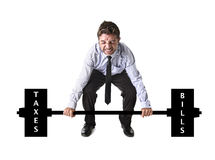 Corporate composite of young attractive businessman power lifting heavy weights taxes and bills Royalty Free Stock Image