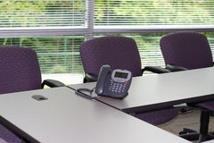 Corporate Conference Room. Conference room with windows and a phone in a large company Stock Photo