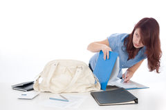 Corporate data leakage. And social engineering problem. Woman undercover examine file leaves on office table with secret corporate information Royalty Free Stock Photo