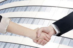 Corporate deal. Hands shake after making a deal in a corporate environment stock images