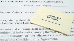 Legal Non-Disclosure Agreement. A business nondisclosure agreement with an Approved By Legal stamp Royalty Free Stock Images