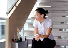 Corporate Downsizing. Downsizing, sad business woman Sitting on Stairs Stock Image