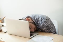 Corporate Employee Sleeping On His Laptop Keyboard After Deadlin Stock Photo