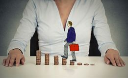 Corporate employee walking up coin stack ladder Stock Photography