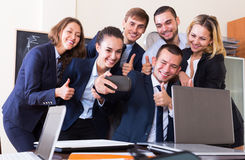 Corporate employees photoshooting together. Happy corporate employees photoshooting together using mobile phone Royalty Free Stock Image