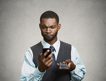Corporate executive holding mobile phone and calculator Royalty Free Stock Photo