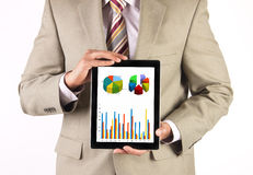 Corporate executive making a presentation. Businessman and CEO presenting and analyzing corporate financial data using a tablet computer Stock Images