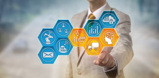 Corporate Executive Monitoring Supply Chain. Unrecognizable corporate executive monitoring supply chain via touch screen. Business operations and IT concept for royalty free stock images
