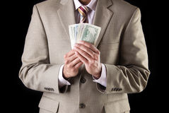 Corporate executive showing currency. Corporate business man showing and counting money, american dollars Royalty Free Stock Photos