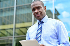 Corporate executive using a tablet pc Stock Image